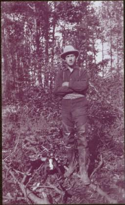 Taku River Survey - Unknown Man & Dog Standing in Forest