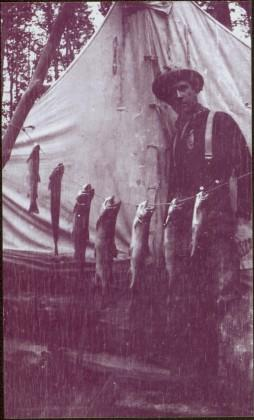 Taku River Survey - Man Standing with Catch of Fish