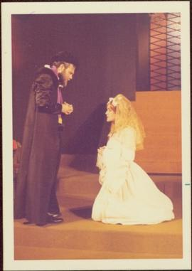 May Diver in Costume as Mary Stuart, kneeling before unidentified man