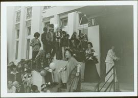 Iona Campagnolo and many unidentified children and adults watching Muriel Brown's performance as ...