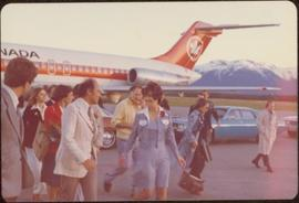 Iona Campagnolo leading Pierre Trudeau from his plane, June 1974