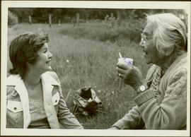 Iona Campagnolo talking to Agnes Sutton in a field at Usk, 1974