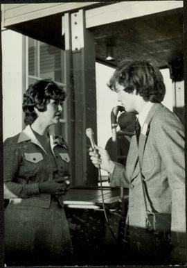 Iona Campagnolo being interviewed by a young male reporter