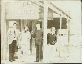 John Hanquest, Iona Campagnolo, and two unidentified men raise bottles of beer outside the First ...