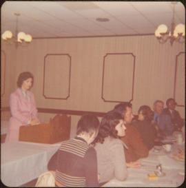 M.P. Iona Campagnolo speaking at a podium in a conference room, Terrace, BC