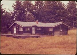 Brown wooden house where the Trudeaus stayed during their visit [?], Tlell, Haida Gwaii, 1976