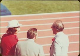 Minister Iona Campagnolo speaking to unidentified man and Prime Minister Pierre Trudeau, 1976 Sum...