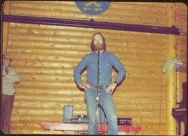 Unidentified man on stage during tour to bring television access from Yukon to Atlin, 1977