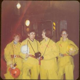 Minister Iona Campagnolo with Mary Schindel and two unidentified women; all wear yellow safety su...