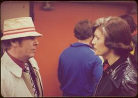 Iona Campagnolo speaking to an unidentified man wearing a bucket hat