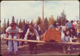 Skeena Riding tour - Iona Campagnolo assists in raising a totem pole carved by Walter Harris, Kis...