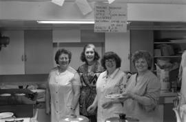 Iona Campagnolo, Hilde Voss, Martha Wallenborn, and Vivian Cousins at a pancake breakfast in Cassiar