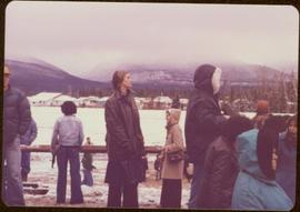 Raising of Eli Gosnell's Pole, New Aiyansh, November 1978 - Iona Campagnolo stands outside in the...