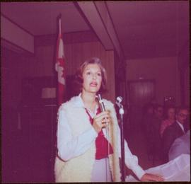 Iona Campagnolo speaking into a microphone at Chetwynd, BC