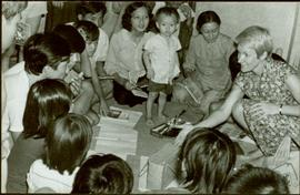 CUSO Mission, North-eastern Thailand - Unidentified group kneels on floor