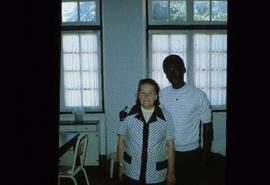 Unidentified woman and young man in a classroom at overseas location