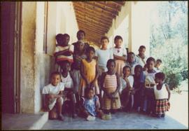 CUSO Mission in Angola - Group of unidentified children pose on a patio