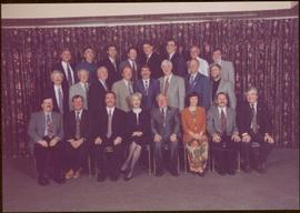 Iona Campagnolo sitting in the centre of a group portrait of the Children's Aid Society of Algoma...