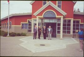 Chancellor's Tour - Iona Campagnolo in group outside the Tumbler Ridge Town Hall