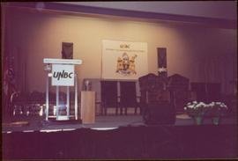 Ceremonial chairs onstage in front of UNBC banners, May 1994