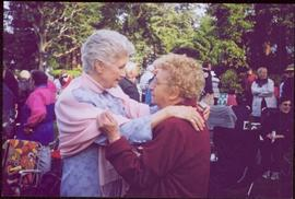 Iona Campagnolo embracing a woman named Hlia at a garden function in Victoria, BC