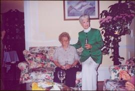 Iona Campagnolo sits beside a woman named Hlia on couch in unknown room, Victoria, BC