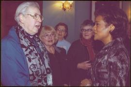Four unidentified women speak with Governor General Michaëlle Jean