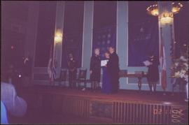 Lieutenant Governor Iona Campagnolo and unidentified man present an award to unidentified woman o...