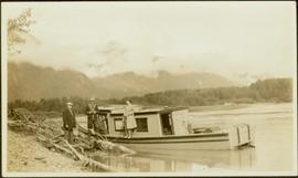 Joyce Collison, Tom Moorhouse, medical officer & unidentified man by boat on Nass River, BC