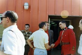 Prime Minister Trudeau shaking hands with an RCMP constable