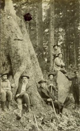Archdeacon WH Collison and friends reclining against tree
