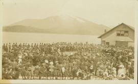 Crowd and band gathered by the water, Prince Rupert BC