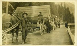 Convoy of carriages going over a bridge in Stewart, BC
