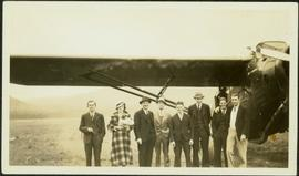 H.F. Glassey in Group by Airplane
