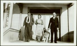 H.F. Glassey with Couple at Main Doors