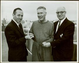 Ray Williston receiving silver teaspoons