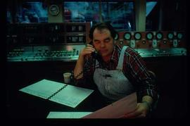 Pulpmill - General - Man on phone in control room
