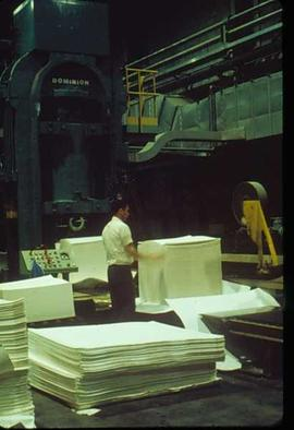 Pulpmill - General - Man working with stacked paper