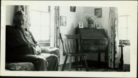 Knox McCusker sitting in his living room