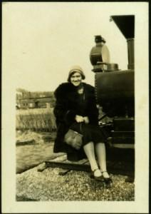 Violet Taylor Seated on Engine of Train