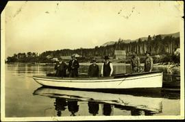 Hugh Taylor Sr. in Boat with H. G. T. Perry