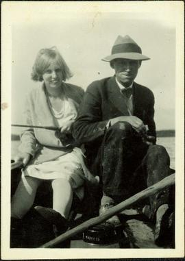 Man and Woman Sitting in Boat