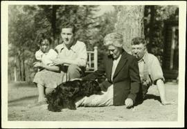 Baxter Family Seated on Ground with Dog