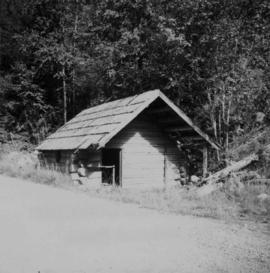 Log cabin beside lower Arrow Lake