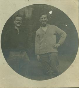 (L-R) Unidentified man standing with R. A. Harlow