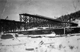 Building structure near a train in an unknown location